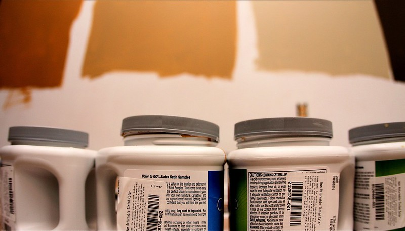 line of paint cans